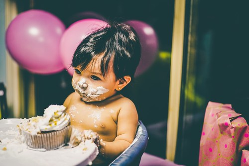 Baby eating cake at party - Chris Benson/Unsplash - AuthorPalessa.com